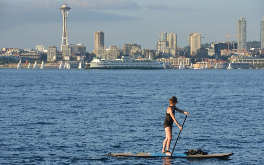 Woman paddle boarding in Puget Sound